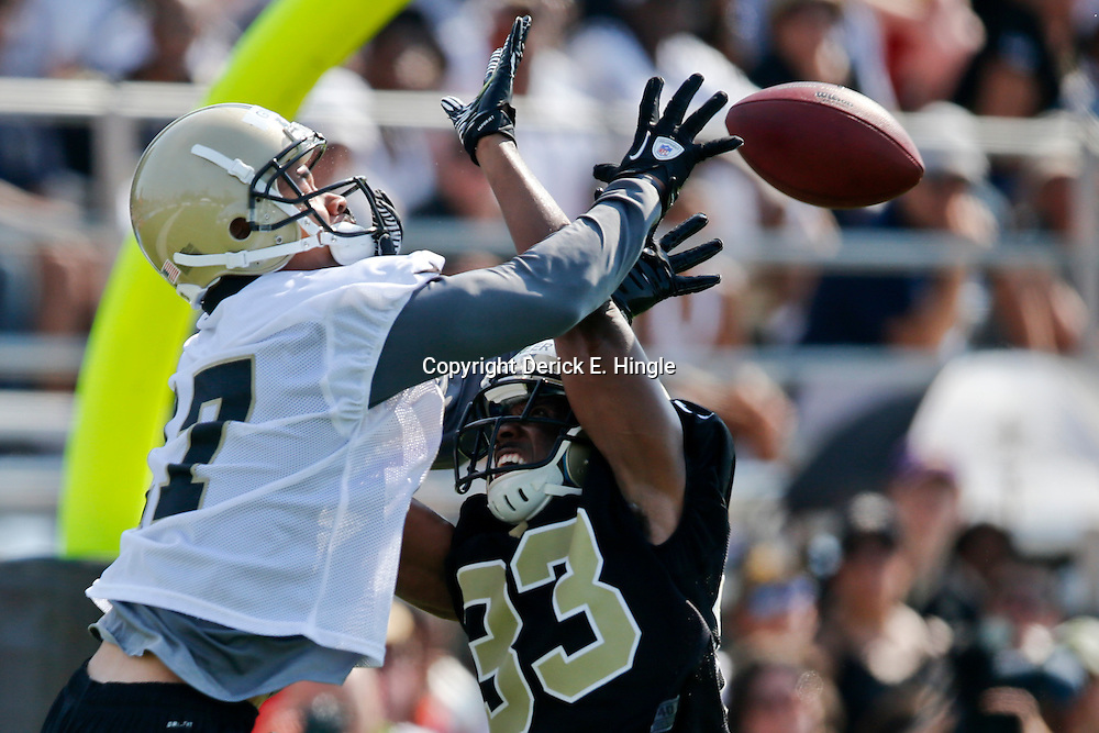 Jul 26, 2013; Metairie, LA, USA; New Orleans Saints defensive back Jabari Greer (33) breaks up a pass to wide receiver Chris Givens (17) during the first day of training camp at the team facility. Mandatory Credit: Derick E. Hingle-USA TODAY Sports