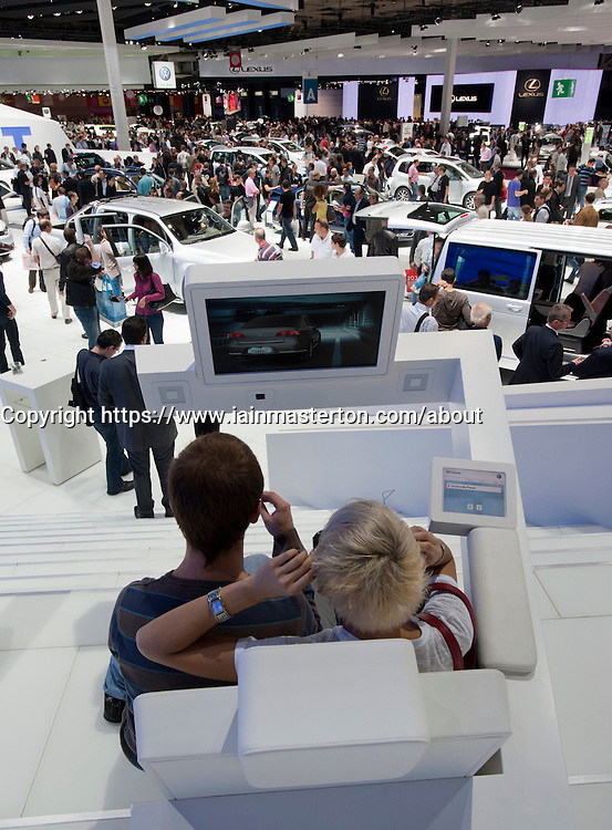 Visitors using 3D television at Paris Motor Show 2010