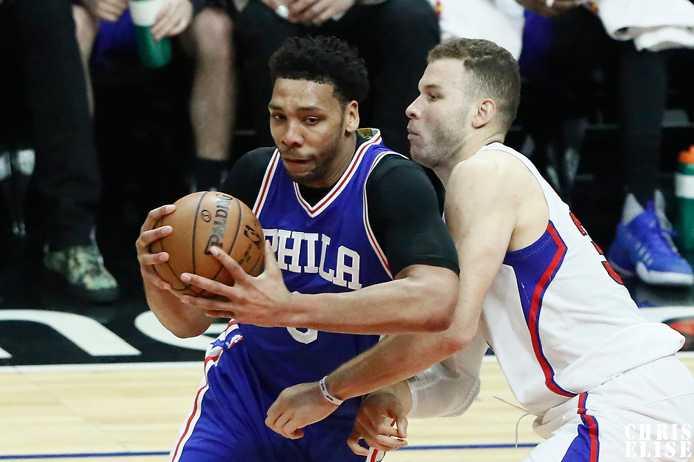 11 March 2017: Philadelphia 76ers center Jahlil Okafor (8) drives past LA Clippers forward Blake Griffin (32) during the LA Clippers 112-100 victory over the Philadelphia Sixers, at the Staples Center, Los Angeles, California, USA.