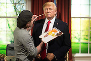 UNITED KINGDOM, London: 18 January 2017 The wax figure of President Elect Donald J. Trump gets the final make-up touches by Chris Gargiulo in the Madame Tussauds London's Oval Office section at its unveiling today. The London wax figure is one of four Trump figures created by Madame Tussauds globally, the others are in Washington D.C, New York and Orlando. Rick Findler / Story Picture Agency