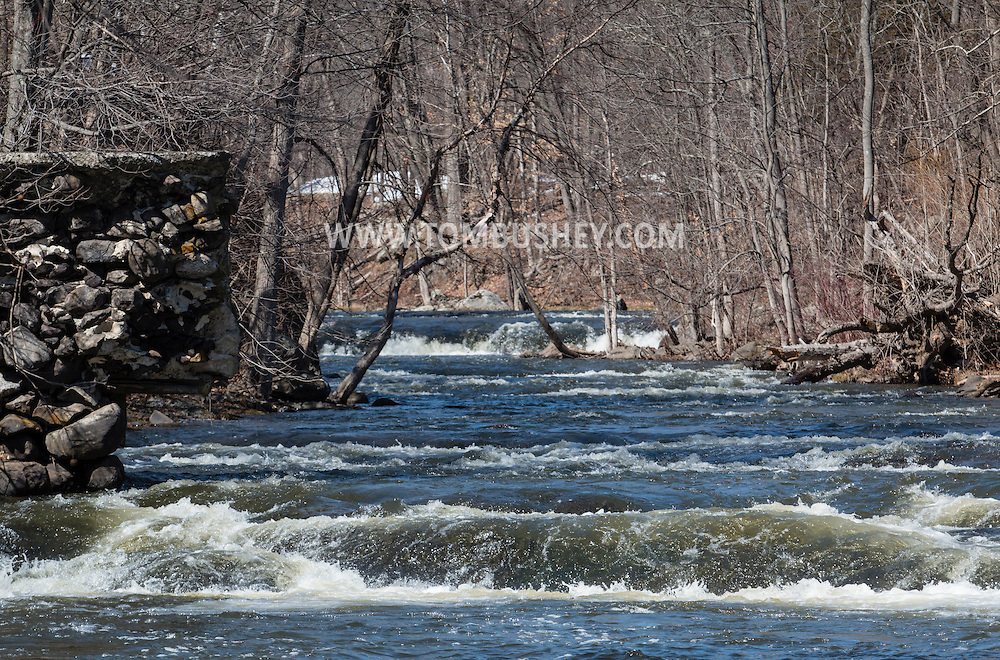 Wawayanda, New York - Rutgers Creeks flows over stones at the site of a former mill on March 22, 2015.