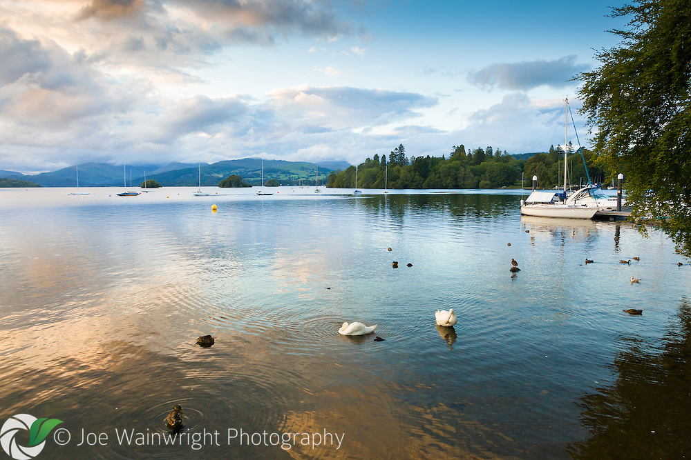 As the holidaymakers disperse, Windermere is transformed into a place of peace and beauty - with swans skirting the shore and yachts swaying gently on the placid waters.