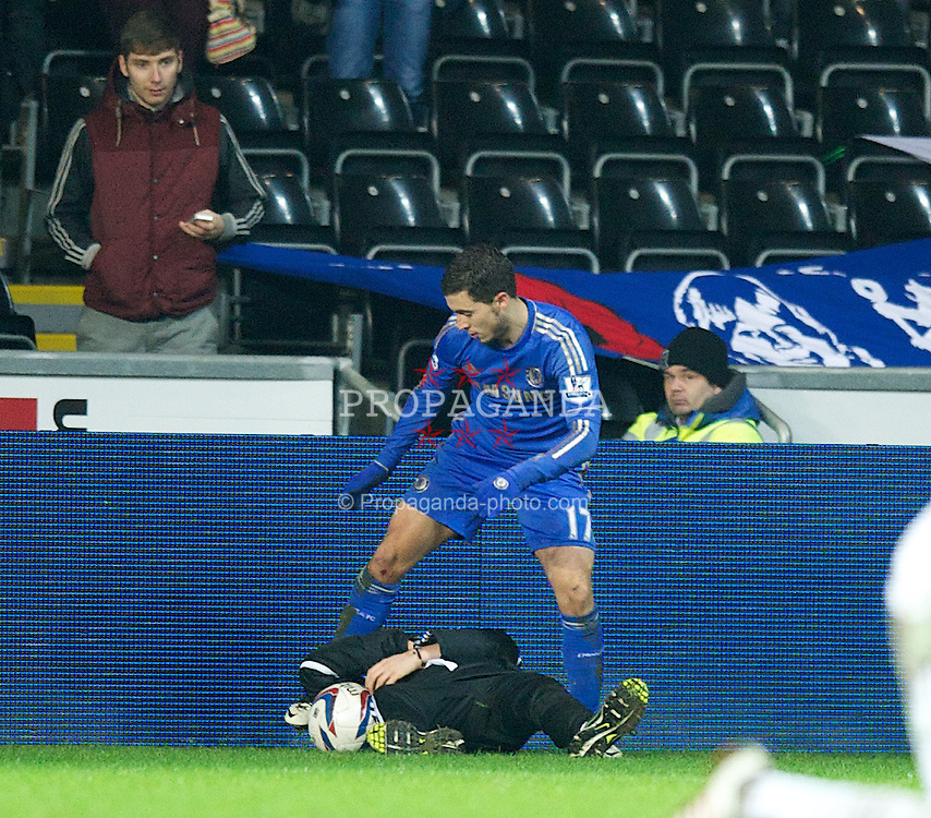 SWANSEA, WALES - Wednesday, January 23, 2013: Chelsea's Eden Hazard kicks out at Swansea City ball-boy Charlie Morgan, was was sent off, during the Football League Cup Semi-Final 2nd Leg match at the Liberty Stadium. (Pic by David Rawcliffe/Propaganda)