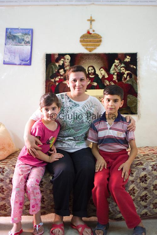 Bahzani, Mosul, Iraq: Family portrait in a christian house