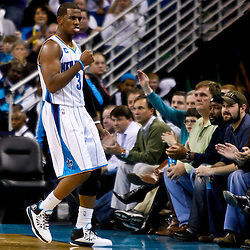 December 15, 2010; New Orleans Hornets point guard Chris Paul (3) reacts after scoring a basket during the second half against the Sacramento Kings at the New Orleans Arena. The Hornets defeated the Kings 94-91. Mandatory Credit: Derick E. Hingle