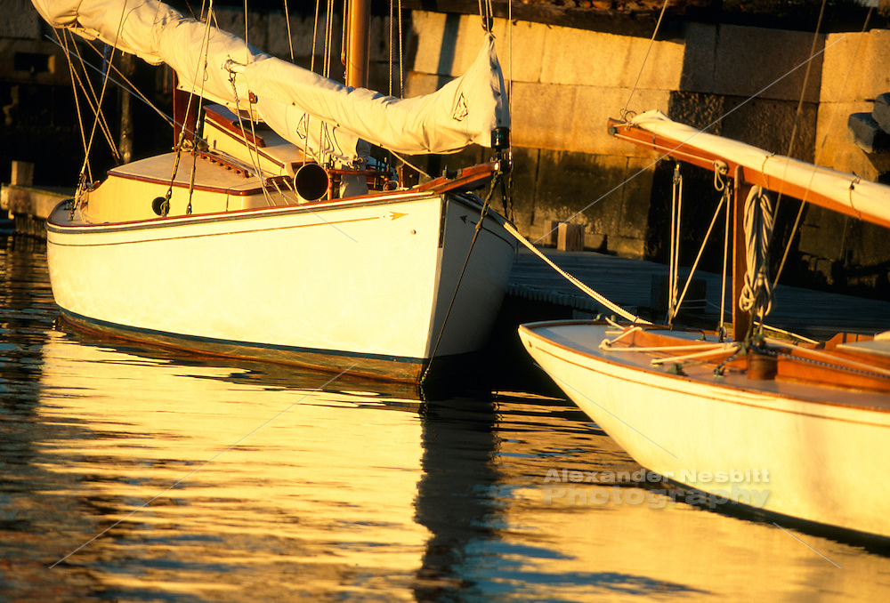 Usa, Newport RI -Sailboats docked at the Newport Yacht Museum in the late afternoon sun..