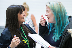 © Licensed to London News Pictures . 20/08/2015 . Salford , UK . ELEANOR SUNDERLAND (r) gets her results . Students at St Patrick's RC High School in Eccles collect their GCSE results . Photo credit : Joel Goodman/LNP