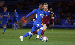 Siriki Dembele of Peterborough United in action with Lewis O'Brien of Bradford City - Mandatory by-line: Joe Dent/JMP - 01/12/2018 - FOOTBALL - ABAX Stadium - Peterborough, England - Peterborough United v Bradford City - Emirates FA Cup second round proper