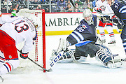 WINNIPEG, MB - DECEMBER 10: Cam Atkinson #13 of the Columbus Blue Jackets puts the puck in the net past an outstretched Connor Hellebuyck #30 of the Winnipeg Jets during third period action at the MTS Centre on December 10, 2015 in Winnipeg, Manitoba, Canada. (Photo by Darcy Finley/NHLI via Getty Images)