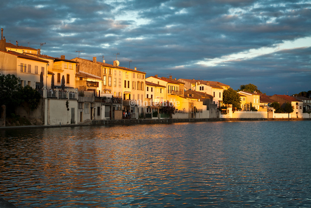house on the water edge at sunset The Grand Basin of Canal du Midi at Castelnaudary France