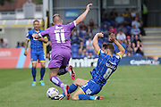 Jake Reeves of AFC Wimbledon tackles Gregg Wylde during the Sky Bet League 2 match between AFC Wimbledon and Plymouth Argyle at the Cherry Red Records Stadium, Kingston, England on 8 August 2015. Photo by Stuart Butcher.