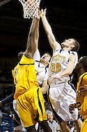 26 January 2010:  Kent State's Justin Greene (34), Toledo's Jordan Dressler (42) and Toledo's Jake Barnett (30) during the NCAA basketball game between Kent State and the Toledo Rockets at Savage Arena in Toledo, OH.
