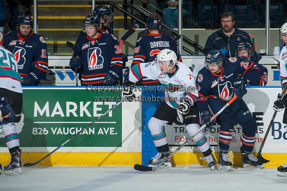 KELOWNA, CANADA - MARCH 11: Jonathan Smart #6 of Kelowna Rockets is checked by Quinn Banjafield #22 of Kamloops Blazers on March 11, 2016 at Prospera Place in Kelowna, British Columbia, Canada.  (Photo by Marissa Baecker/Shoot the Breeze)  *** Local Caption *** Quinn Banjafield; Jonathan Smart;