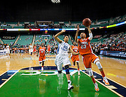 Clemson's Chancie Dunn (23) attempts to score on this layup over North Carolina's Chay Shegog (20) during UNC's 78 - 64 opening round victory in the 2011 ACC Women's Basketball Tournament held at the Greensboro Coliseum in Greensboro, North Carolina.  (Photo by Mark W. Sutton)
