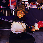 Indigenous peoples selling native wares in the open market of Salasaca, Ecuador.