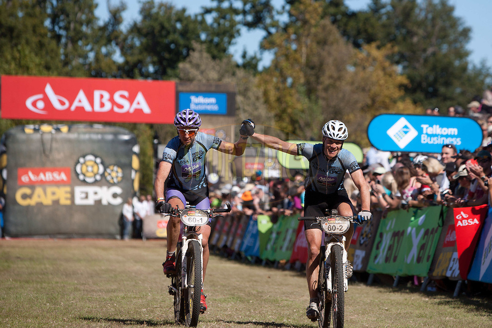 Telkom Business Masters winners BArt Brentjens and Jan Weevers of World Bicycle Relief finish during the final stage (stage 7) of the 2012 Absa Cape Epic Mountain Bike stage race held from Oak Valley Wine Estate in the Elgin Valley to Lourensford Wine Estate, South Africa on the 1 April  2012..Photo by Karin Schermbrucker/Cape Epic/SPORTZPICS
