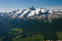 Large clearcut forest below Mount Matier (left 2783 m -9131 ft) and Joffre Peak (2721 m -8927 ft) seen from ridge of Mount Rohr British Columbia Canada