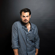 "August 5, 2014 - New York, NY : Jack Bryan, a writer, producer, and director of independent films, poses for a portrait in his Williamsburg, Brooklyn apartment on Tuesday afternoon. Bryan's past works have included the films ""Life After Dark: The Story of Siberia Bar,"" ""And After All,"" and most recently, ""The Living."" CREDIT: Karsten Moran for The New York Times"