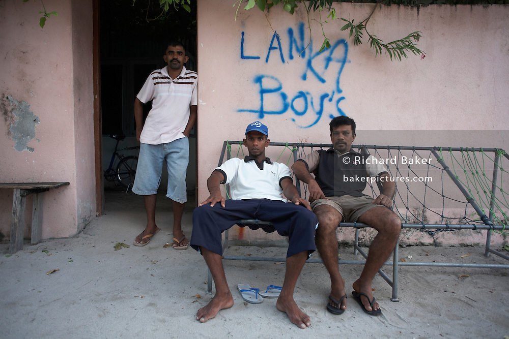 Sri Lankan fishermen outside their communal home at the Cyprea Marine Foods factory island of Himmafushi, Republic of Maldives.