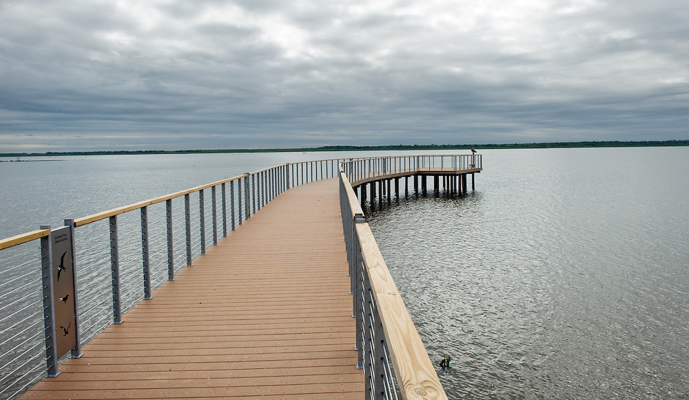 A boardwalk that is part of the Lakeside Observatory extends into Thompson Lake at The Nature Conservancy's Emiquon Preserve near Havana. The observatory is one of two, including the Wetland Observatory with an 880-foot   built as part of the