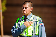 04 AUGUST 2010 -- GILBERT, AZ:  Mesa Police Explorer Luz Diaz (CQ LUZ not Luis) stands hand over heart as the body of Det Carlos Ledesma enters Mission Community Church at the funeral for Chandler police detective Carlos Ledesma Wednesday. Ledesma was killed during a shoot out with suspected drug dealers during an undercover operation in south Phoenix Wednesday July 28. PHOTO BY JACK KURTZ