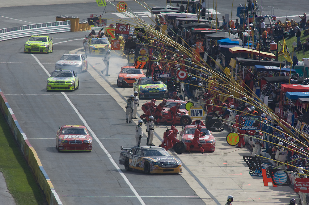 Cars in the pit at Nascar Race at Dover Speedway
