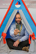 Gali Janach squeezes into a Myweeteepee - The London Toy Fair opens at Olympia exhibition centre. Organised by the British Toy and Hobby Association it is the only dedicated toy, game and hobby trade exhibition in the UK. It runs for three days, with more than 240 exhibiting companies ranging from the large internationals to the new start up companies.