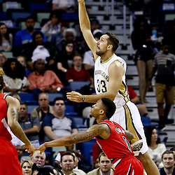 Mar 18, 2016; New Orleans, LA, USA; New Orleans Pelicans forward Ryan Anderson (33) shoots over Portland Trail Blazers guard Damian Lillard (0) during the first quarter of a game at the Smoothie King Center. Mandatory Credit: Derick E. Hingle-USA TODAY Sports