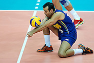 Brazil's Mario Da Silva Pedreira Junior (left) receives the ball while volleyball match between Brazil and Russia during the 2014 FIVB Volleyball World Championships at Spodek Hall in Katowice on September 14, 2014.<br /> <br /> Poland, Katowice, September 14, 2014<br /> <br /> For editorial use only. Any commercial or promotional use requires permission.<br /> <br /> Mandatory credit:<br /> Photo by © Adam Nurkiewicz / Mediasport
