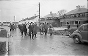01/04/1963<br /> 04/01/1963<br /> 01 April 1963<br /> Students from Bolton Street College of Technology visit &quot;Greenfield&quot; (Wates) Housing Estate at Ballymun, Dublin.  Mr George Madden, storekeeper at Wates Greenfield Estate and Mr. William Gilligan, B.A., M.R.I.A.I., showing a group of students around the estate.