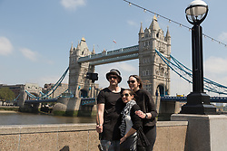 © Licensed to London News Pictures. 13/06/2016. LONDON, UK.  Tourists take a selfie in front of Tower Bridge during sunny spring weather at lunchtime.  Photo credit: Vickie Flores/LNP
