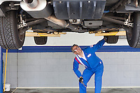 Mechanic checking the car at automobile repair shop