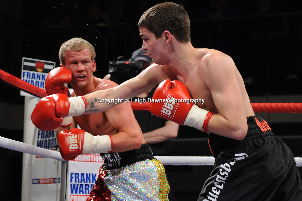 Super Featherweight Billy Morgan (black shorts) defeats Robin Deakin at York Hall, Bethnal Green, London on the 19th February 2011. Frank Warren Promotions. Photo credit © Leigh Dawney.