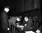 18/11/1952<br /> 11/18/1952<br /> 18 November 1952<br /> 90 Garda recruits attesting, being sworn in at the Garda Depot, Phoenix Park, Dublin.