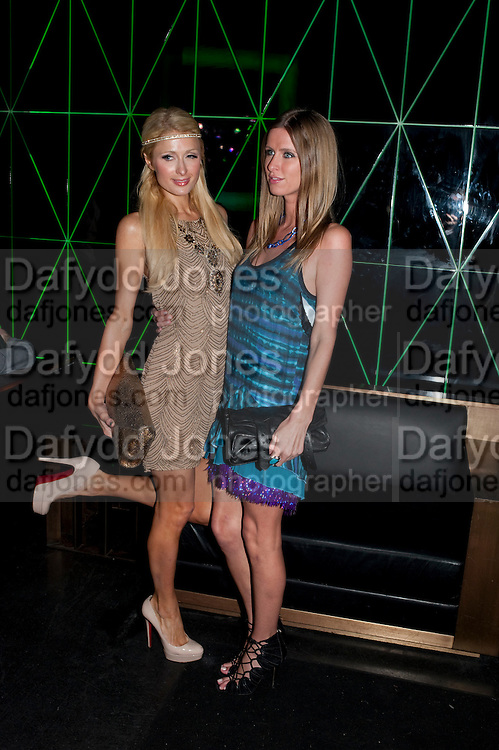 PARIS HILTON; NICKY HILTON, After party for hosted by Alex Dellal, Stavros Niarchos, and Vito Schnabel celebrate Dom PŽrignon Luminous. W Hotel Miami Beach. Opening of Miami Art Basel 2011, Miami Beach. 1 December 2011. .<br /> PARIS HILTON; NICKY HILTON, After party for hosted by Alex Dellal, Stavros Niarchos, and Vito Schnabel celebrate Dom Pérignon Luminous. W Hotel Miami Beach. Opening of Miami Art Basel 2011, Miami Beach. 1 December 2011. .
