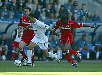Photo. Andrew Unwin<br /> Bolton Wanderers v Middlesbrough, Barclaycard Premier league, Reebok Stadium, Bolton 13/09/2003.<br /> Bolton's Youri Djorkaeff powers away from Middlesbrough's George Boateng (r).