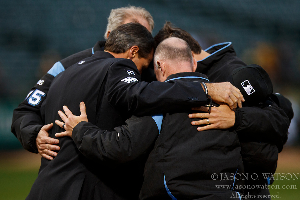 OAKLAND, CA - APRIL 04:  MLB umpires Angel Hernandez, Lance Barksdale, John Tumpane and Ted Barrett huddle before the game between the Oakland Athletics and the Los Angeles Angels of Anaheim at the Oakland Coliseum on April 4, 2017 in Oakland, California. The Los Angeles Angels of Anaheim defeated the Oakland Athletics 7-6. (Photo by Jason O. Watson/Getty Images) *** Local Caption *** Angel Hernandez; Lance Barksdale; John Tumpane; Ted Barrett