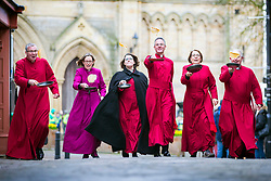 © Licensed to London News Pictures. 05/03/2019. Ripon UK. Clergy from Ripon Cathedral take part in the annual pancake race down Kirkgate in Ripon to celebrate Shrove Tuesday in Yorkshire. Photo credit: Andrew McCaren/LNP