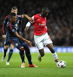 Arsenal's Yaya Sanogo battles for the ball with Bayern Munich's Jerome Boateng - Photo mandatory by-line: Joe Meredith/JMP - Tel: Mobile: 07966 386802 19/02/2014 - SPORT - FOOTBALL - London - Emirates Stadium - Arsenal v Bayern Munich - Champions League - Last 16 - First Leg