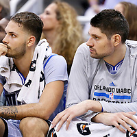 30 October 2015: Orlando Magic guard Evan Fournier (10) is seen on the bench next to Orlando Magic center Nikola Vucevic (9) during the Oklahoma City Thunder 139-136 double overtime victory over the Orlando Magic, at the Amway Center, in Orlando, Florida, USA.