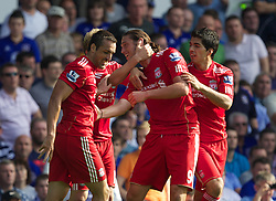 LIVERPOOL, ENGLAND - Saturday, October 1, 2011: Liverpool's Andy Carroll celebrates scoring the first goal against against Everton with team-mate Jose Enrique and Luis Alberto Suarez Diaz during the Premiership match at Goodison Park. (Pic by Vegard Grott/Propaganda)