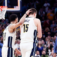 01 April 2018: Denver Nuggets guard Jamal Murray (27) is seen next to Denver Nuggets center Nikola Jokic (15) during the Denver Nuggets 128-125 victory over the Milwaukee Bucks, at the Pepsi Center, Denver, Colorado, USA.