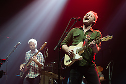 © Licensed to London News Pictures. 10/12/2014. London, UK.   Hiss Golden Messenger performing live at Brixton Academy, supporting headliner Ben Howard.  In this picture Scott Hirsch (right).  Hiss Golden Messenger is an American folk music duo, originating from North Carolina consisting of MC Taylor and Scott Hirsch.   Photo credit : Richard Isaac/LNP