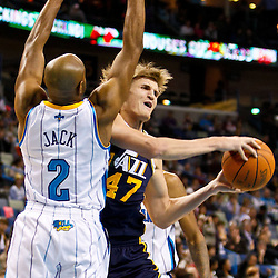 December 17, 2010; New Orleans, LA, USA; Utah Jazz small forward Andrei Kirilenko (47) is defended by New Orleans Hornets point guard Jarrett Jack (2) during the first half at the New Orleans Arena.  Mandatory Credit: Derick E. Hingle