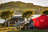 Trondelag, Norway, July 2015. Koa Camping is idyllically situated by the Trondheim fjord in the municipality of Inderøy. Trøndelag lies at the heart of Norway's identity. The rolling hills of the interior with its traditional ox-blood coloured farm houses grow a wealth of produce. In the west the coastline is sculpted by a maze of fjords and islands home to small fishing communities. Photo by Frits Meyst / MeystPhoto.com