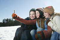 Three girls take self portrait with camera phone