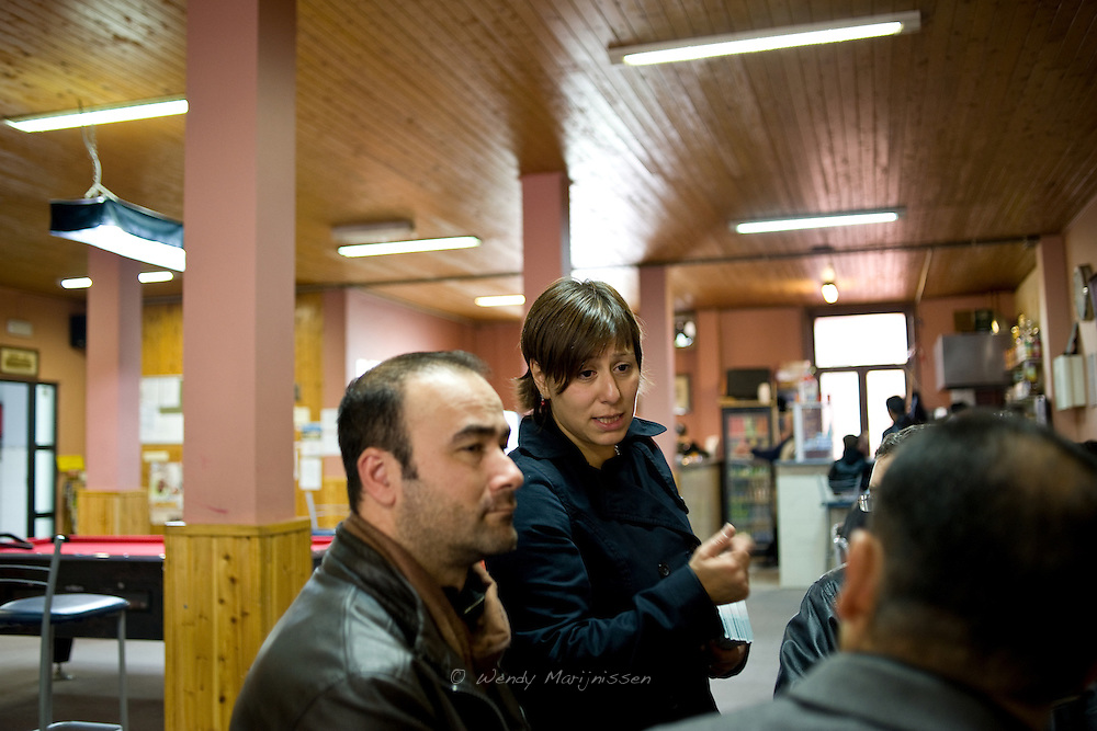 Meyrem Almaci answers questions and discuss political issues with men in the community room of the mosque after the friday prayer. Antwerpen, Belgium, 2012