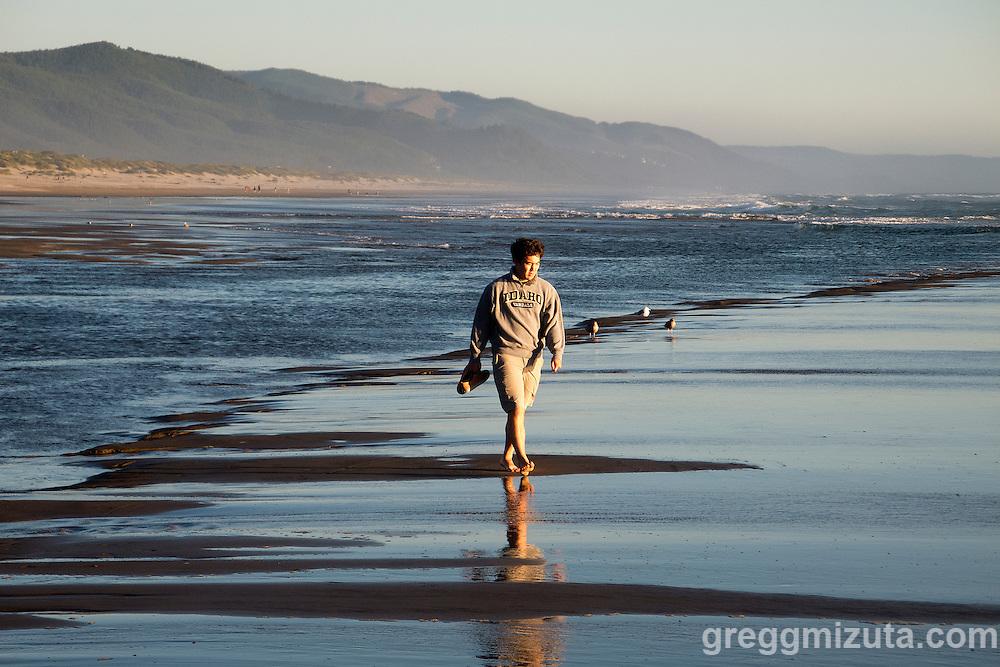 Brett Mizuta on the beach at Manzanita, Oregon, July 30, 2015,