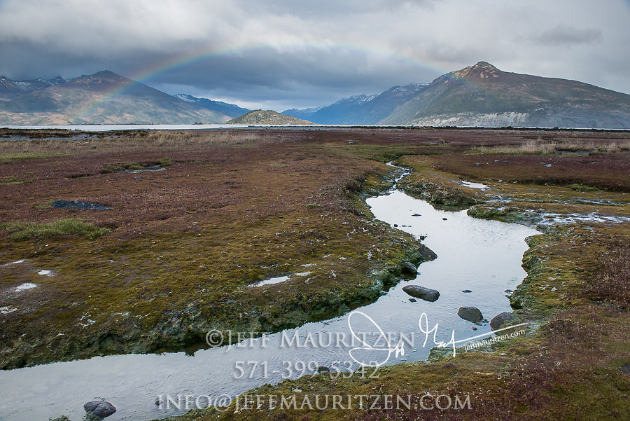 Rainbow over a small creek in Ainsworth Bay, Tierra del Fuego, Chile.