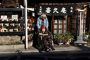 Kawasaki, November 21 2014 - Japanese artist Tatsumi ORIMOTO, 69, having a lunch outside in a soba (japanese noodle) restaurant with his 97-year-old mother.
